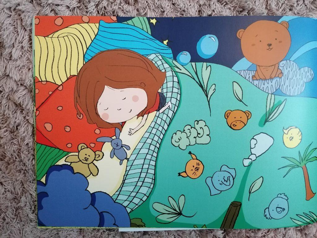 page du livre personnalisé Ty Môme Rose dans son lit